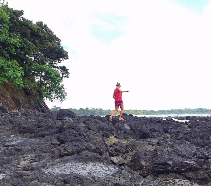 Things to do in Santa Catalina Panama - Girl Climbing rocks